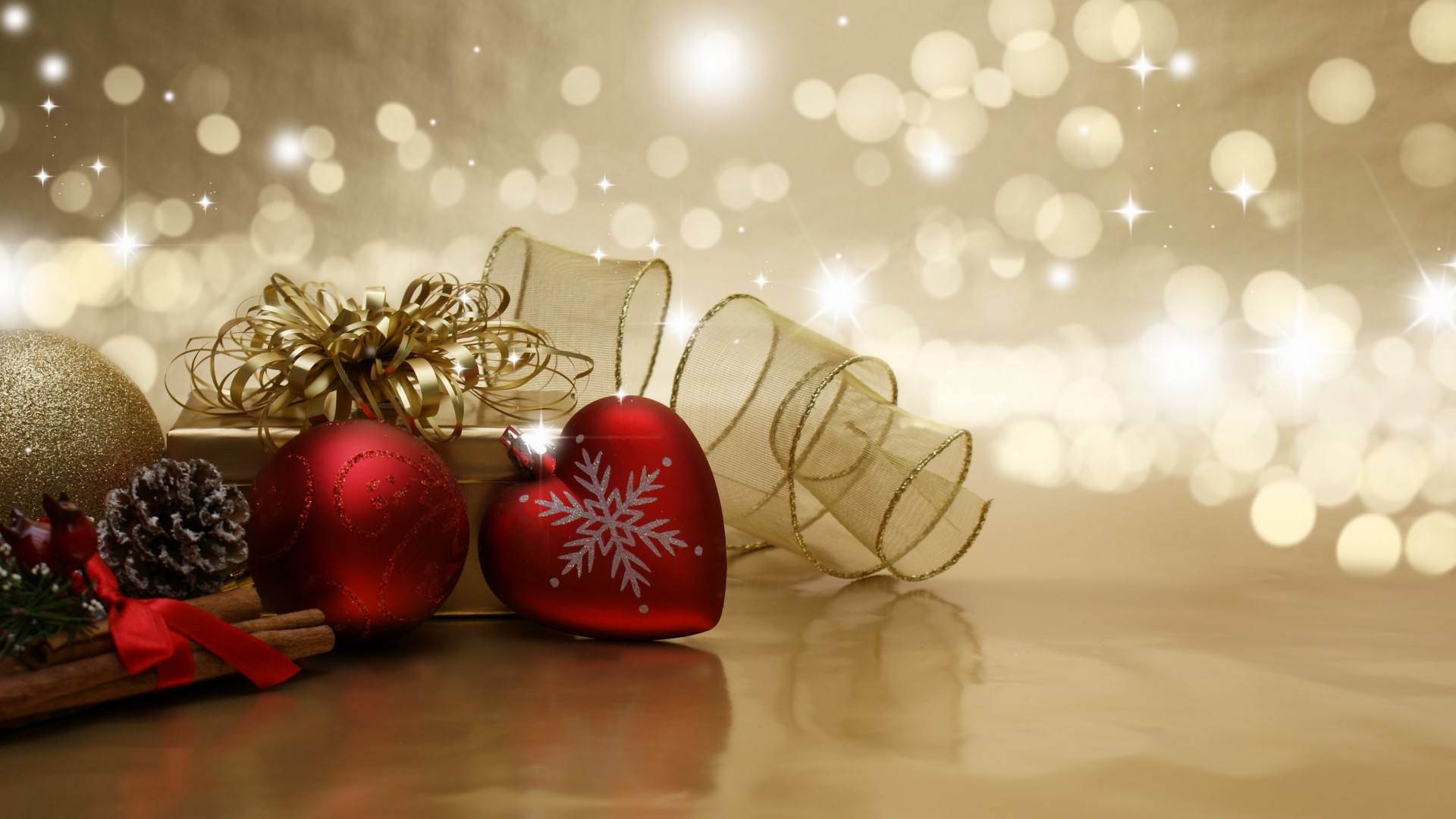 Decorative Christmas background with baubles, gifts and ribbon with bokeh lights