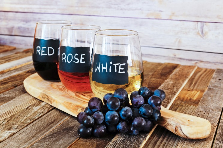 Three color wine flight in label glasses close up